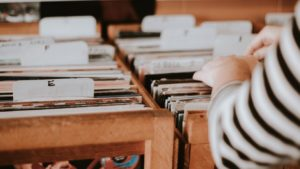 person looking through records