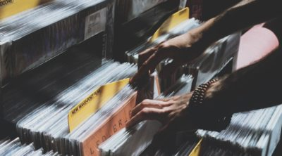 person sorting through vinyl records